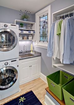 Small and square laundry room with stackable washer dryer.