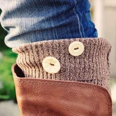 Take a trip to the thrift shop and bring home a sweater.  Cut off the sleeves and turn them into cute and stylin' boot toppers.