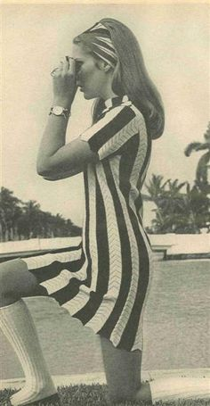 She is wearing knee socks w/ loafers not boots, been there ,done that late 60's to early 70's. ALady. gogo boots and stripes, what can go wrong?