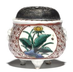 A Ko-Kutani incense burner with a pierced silver cover Edo period (late 17th century)