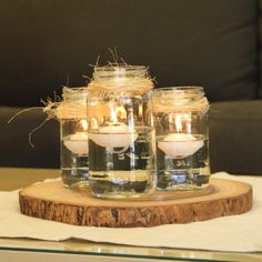Rustic Mason Jar Centerpiece with Floating Candles - Beau-coup.com - Love these!