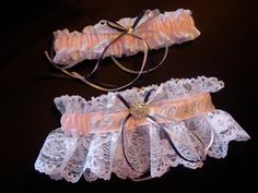 White lace and pink satin created a sparkling wedding garter set with rhinestones and initial/date embroidery personalization. TheWeddingGarter.com