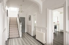 Beneath a sparkling chandelier, the impressive entrance hall features a floor tiled in Fired Earth 'Patisserie' tiles Victorian Hallway, Victorian Townhouse, Victorian Homes, Hall Tiles, Tiled Hallway, Edwardian Haus, Hall Flooring, Flur Design, House Entrance