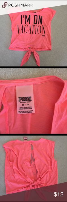 """VS Pink open back T-shirt/Tank VS pink open back cropped tee with """"I'm on vacation"""" logo on the front. The back can tie together. Size XS. Hot pink and black writing. PINK Victoria's Secret Tops Muscle Tees"""