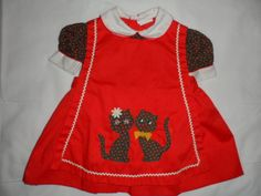 1970s Toddlers dress with pussycats on apron