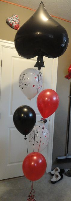 Casino themed balloon bouquet to mark the party location.