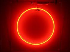 orange circle neon hire sign
