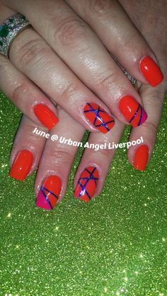 Orange nails with striped nail art
