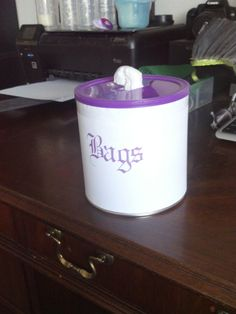 Bag dispenser from an old formula can :) would be cute in the bathroom for trash bags