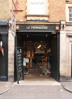 La Fromagerie nestled just off Marylebone High Street is a snug and atmospheric cafe and cheese cellar. It's a space that should feel cold with exposed brickwork and groaning rustic shelves stacked with cheese and bread but is intimate and like stepping into a dark Dutch Still Life – with walls strung with herbs and while globes of cheese wrapped in muslin . The decor is wholesome and simple with the cafe dotted with rustic wood tables and chairs.