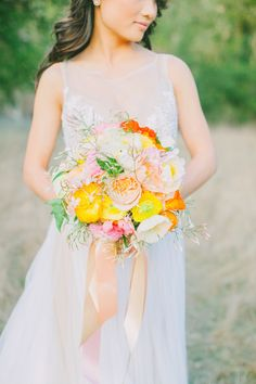 Wedding Bouquet - on http://www.StyleMePretty.com/2014/04/07/cheerful-spring-inspiration-shoot/ poppies, ranunculus, garden roses, jasmine vines by VoFloralDesign -- Photography: AvecLamourPhotography.com