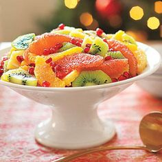 """""""Holiday recipes: Winter Fruit Salad."""" I don't know if kiwis count as """"winter fruit,"""" but it sure looks fantastic. Citrus, kiwi, and pomegranate, maybe with a honey-lime dressing... mmm. 