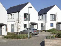 Gable fronted townhouses following passive design principles. Broadclose Farm, Devon.