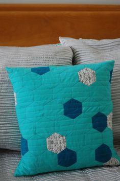 hexagon cushion in shades of blue