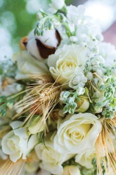 Lovely white roses and wheat for a lush bridal bouquet! View more from this country-couture Knoxville wedding at @castletonfarms with photos by Bryan Allen! Flowers by @samuelfranklins | The Pink Bride www.thepinkbride.com