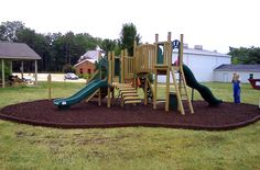 Great outdoor idea: using Rubber Timbers the frame the playground or landscaping