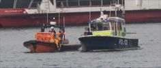 Thames Lifeboat and Police launch recovering a ............?