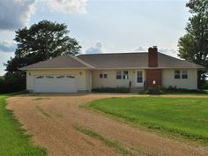 Excellent price and 1.48 acres in the country.  This is for you  3 bedrooms 1.5 baths hardwood floors updated kitchen full basement oversized 2 car garage plus corn crib with metal roof  New last month 14000 roof on house and garage.