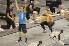 Men competing in the cross fit games 2012