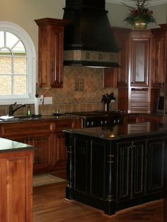 alder cabinets beautiful black kitchen island with bar seating