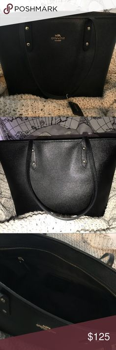 Coach Signature City Zip Tote Fairly new coach purse, in excellent condition. The leather is black with gold hardware. I used it to carry my laptop for school but no longer use it. There are two inside pockets and one zipper pocket on the inside. Open to trades or feel free to make an offer :) Coach Bags Totes