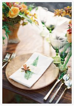 wood charger plates by Elan Rentals + Rustic Elegant Wedding
