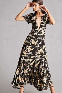 c91a22f48e A woven maxi dress by Nightwalker amp trade  featuring an allover tropical  floral print