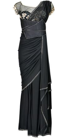 LBD's are always great, but we think a little black sari is just as essential for every wardrobe!  This sari by Tarun Tahiliani is the perfect mix of trendy and traditional and a definite long term investment.  So call your financial planner quick and invest!   Available ONLY through September at www.perniaspopupshop.com