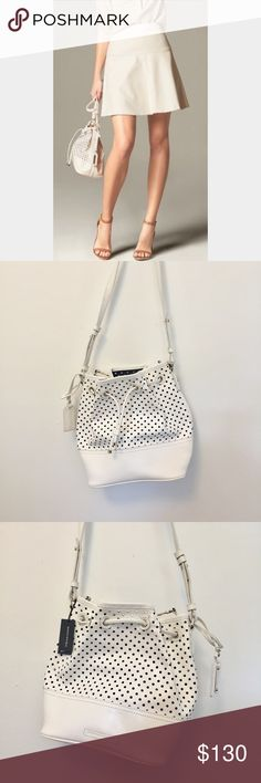 "Banana Republic • Dalia Bucket Bag Banana Republic white bucket bag with holes throughout. Drawstring closure, shoulder strap that is adjustable, very soft flexible leather. 8.5"" by 10"" by 5.5"". New with tags, no flaws. Banana Republic Bags Crossbody Bags"