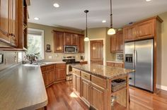 Craftsman Kitchen with http://www.lightingdirect.com/murray-feiss-p1262-weston-1-light-pendant/p2044115, Hardwood floors