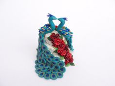 Peacock wedding cake topper with red roses in polymer clay by fizzyclaret