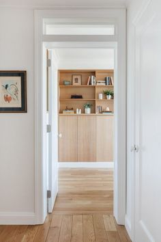 All of the millwork at Riverside Apartment, including the corridors and custom cabinets, are made from Anigre wood – an African hardwood commonly used for furniture and cabinetry.