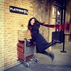 Platform 9¾ in King's Cross | Harry Potter's trolley stuck in the wall at King's Cross station.