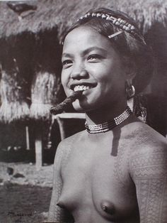 Woman with tattoos & cigar by E. Masferre, Banaue, Philippines