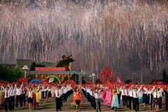 Fireworks explode over participants in a mass dance in the capital's main ceremonial square, a day after the ruling Workers' Party of Korea party wrapped up its first congress in 36 years, in Pyongyang, North Korea, May 10, 2016. REUTERS/Damir Sagolj
