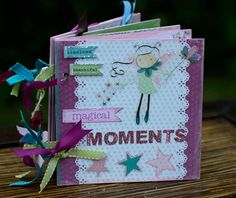 This is a handmade Srapbook Mini Album, designed for scrapbooking a young girl's pictures. The front cover says 'timeless beautiful magical