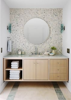 The floating vanity isn't just practical — it's the style of choice for minimalist-design lovers. Tuck a mini stool underneath to make it easier for little hands to reach the sink. DESIGN EXTRA: Tile just one wall. A supersize backsplash creates drama and luxury in a basic bathroom. - GoodHousekeeping.com