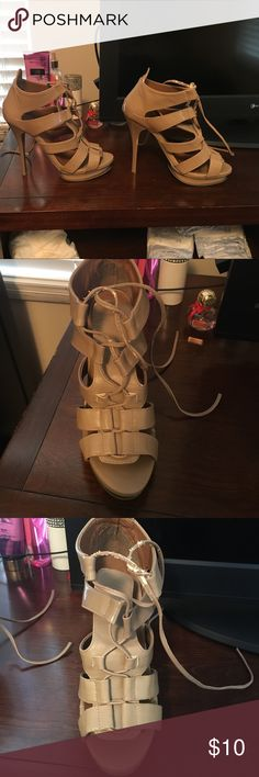Beautiful dark tan high heels Size 7, good condition but there is some flaking on the laces (see pic) I bought these from another posher but they are a little too big for me :( I am not a professional photograph or so if you would like more pictures please ask! Excepting all reasonable offers and discount for bundles! bedazzle Shoes Heels