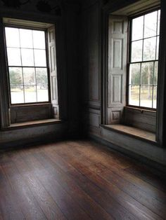 Love those window seats, beautiful moulding, and great old wooden floors.