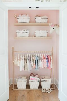 Idea for Montessori bedroom closet with clothes at child level to encourage independent dressing.