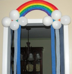 Did something similar for the girls' birthday. Used rainbow streamers and white balloons and swagged them. Turned out cute!