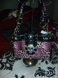 BRAND NEW WITH TAGS!!    Tiger and leopardprint  Silver rhinestoneskull buckleembellishment  Measures 13.5 x 8 x 6  Two outer pockets  Double shoulder straps with chain handles    I have a matching wallet listed as well! Let me know if you'd like both...