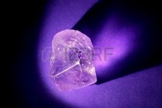 Amethyst macro illuminated with shadows to create contrast