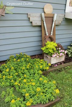 Garden Angel made from an old shutter, table legs, lap siding, grapevine wreath. CUTE!!