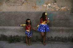 """The most delightfully strange pictures of 2016:      Girls dressed as Wonder Woman attend an annual block party known as """"Cordao de Prata Preta"""", one of the many pre‐carnival parties to take place in the neighbourhoods of Rio de Janeiro."""