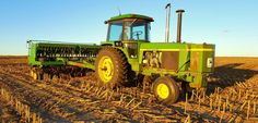 Our John Deere 4430 and John Deere 750 seed drill drilling covercrop rye for the winter. (5312X2988)