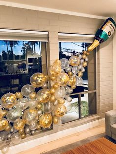 Champagne bottle balloon wall for bachelorette party. This is perfect for any party but especially glam for a New Years Eve party. The confetti balloons really made this perfect. New Year's Eve balloons, champagne balloon wall