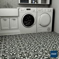 Arte Patterned Tile shown in Black draws inspiration from artisan cement tiles and features a large floral old-world pattern. Tile is 9 3/4 x 9 3/4 and can be used on floors and walls. Also available in White & Gray colors.
