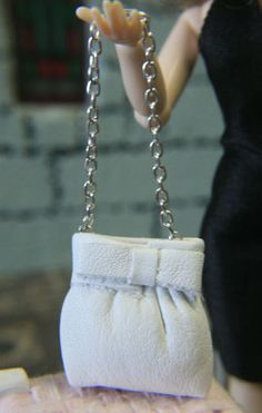 Handmade miniature handbag. White leather with bow decoration. 1/12 scale
