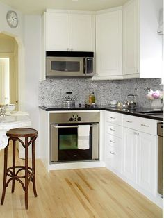 natural hardwood kitchen flooring ideas feat white wooden cabinet and black granite countertop